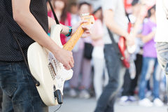 Busking band. The band busked on the street Stock Photo