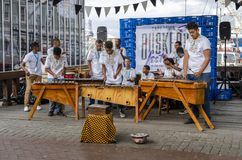 Busking in Cape Town waterfront. A group of African musicians busking and entertaining the crowds in Cape Towns Waterfront October 2017 royalty free stock photos