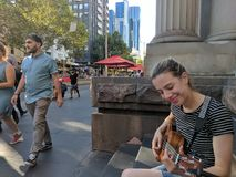 Busking in the city. Playing music and busking on Melbourne& x27;s streets royalty free stock images