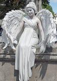 Busking fars i bild av ängeln royaltyfria foton