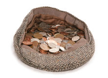 Busking flat cap with change. Studio cutout Royalty Free Stock Photography