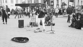 Busking im Trafalgar-Platz Stockfotos