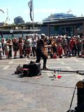 Busking to crowds at Circular Quay, Sydney, NSW, Australia. Busking at circular quay, sydney, , fun, activities, exciting, entertaining, clever, captivating royalty free stock images