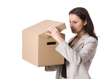 Busnesswoman with curiosity looks to cardboard box Stock Photos