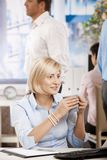 Busnesswoman drinking coffee Stock Image