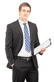 Busniessman posing with clipboard Royalty Free Stock Image