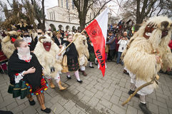 Buso procession med flaggan Royaltyfria Bilder