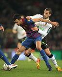 Busquets vies with Soldado Stock Photography