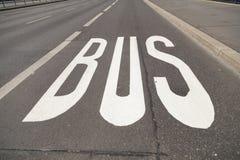 Buss på asfalt Royaltyfria Bilder
