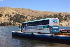 Buss på färjan på sjön Titicaca på Tiquina, Bolivia Fotografering för Bildbyråer