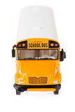 Buss: Skolbuss Toy Isolated On White Arkivbild