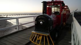 Busselton Train sunset. Busselton, Australia - Dec 30, 2017:Busselton Jetty Train on the longest wooden pier tracks in the world, stretching almost 2 km out to stock video