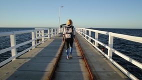 Busselton Jetty enjoying. Carefree young sporty woman at Busselton jetty in Busselton, Western Australia. Happy female over iconic wooden pier in WA. Australia stock video footage