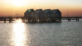 Busselton jetty and setting sun reflected on water. The setting sun is reflected off the water of geographe bay at west australia`s busselton jetty stock footage