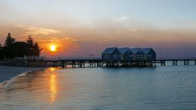 Busselton jetty at sunset wide view in wa. Wide angle view of west australia`s busselton jetty at sunset, the longest jetty in the southern hemisphere royalty free stock images