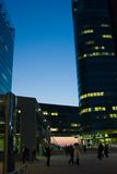 Bussines area with blue sky. Sunset with modern buildings and business people Stock Photos