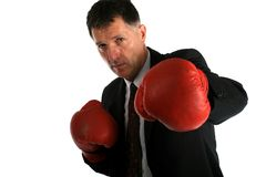 Bussines man with boxing gloves on Stock Photography