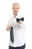 Bussines man choosing tie or bow tie Stock Photography