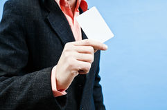 Bussines man empty card. Business man dressed in suite holding white empty card in one hand Stock Photo