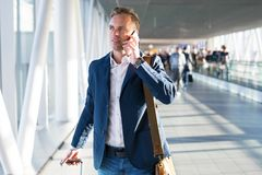 Man talking on phone in airport. Bussines man talking on phone in airport royalty free stock photos