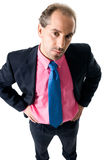 Bussines man wearing pink shirt. High angle portrait of a businessman looking seriously stock photo