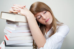 Bussines woman sleep on books stock photo