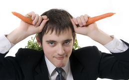 Bussinesman and carrots horns. Isolated. Take the bull by the horns. Concept royalty free stock image