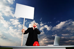 Bussinesman holding sign  Stock Photo