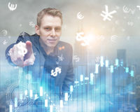 Bussinesman touch futuristic business interface with forex symbo Royalty Free Stock Image