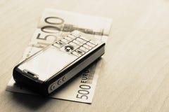 bussiness概念移动电话货币 免版税库存图片