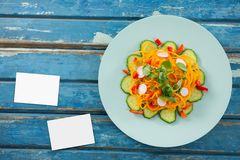Bussiness cards on blue wooden desk with food Royalty Free Stock Images