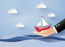 Bussiness concept of freedom and believe. Origami made paper sailing boat on hand. The illustrations do the same paper art and craft style vector illustration