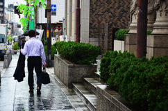 Bussiness japanese man walking Royalty Free Stock Photos