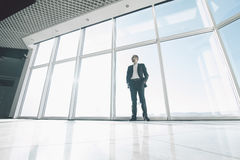 Bussiness man against panoramic windows. Confident business men neat panoramic windows stock images