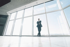 Bussiness man against panoramic windows. Successful bussiness men against panoramic windows stock photo