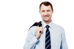 Bussiness man with coat on shoulder Stock Photography