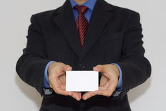 Bussiness man holding a card. With both hands  (focus on the card Royalty Free Stock Image