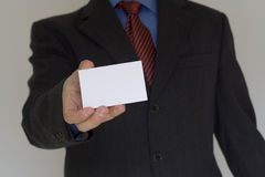 Bussiness man ofering his card. (focus on the card Royalty Free Stock Photo