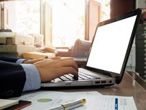 Bussiness man using laptop. On wooden desk Royalty Free Stock Photos