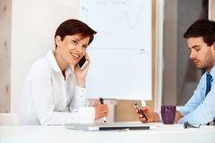 Bussiness people Using Cell Phones in a office Royalty Free Stock Image