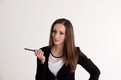 Business Woman Is Explaining Something with Pen  on Whi. Attractive Business Woman is Explaining Something with Pen  on White Background Royalty Free Stock Photo