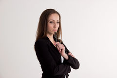 Business Woman is Thinking About Something with Pen  on. Attractive Business Woman is  is Thinking About Something with Pen  on White Background Royalty Free Stock Photo