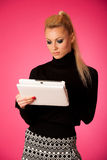 Bussiness woman using tablet computer, reading news and smiling. Royalty Free Stock Images