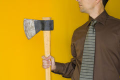 Bussinessman with a axe. An anger bussiness man holding an axe Royalty Free Stock Image