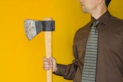 Bussinessman com um machado imagem de stock royalty free