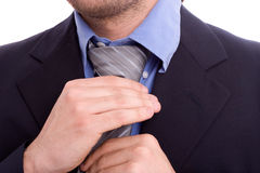 Bussinessman fixing his tie Royalty Free Stock Photography