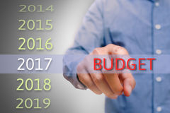 Bussinessman hand pointing budget text for 2017. targets concept. Bussinessman hand pointing budget text for 2017. targets concept Royalty Free Stock Image