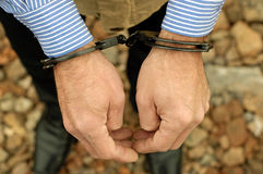 Bussinessman in handcuffs Stock Photos