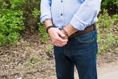 Bussinessman in handcuffs. The man, a businessman in handcuffs. The arrest of the car Royalty Free Stock Images