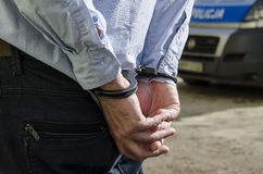 Bussinessman in handcuffs Stock Image